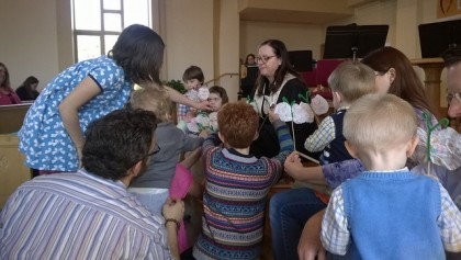 Children and Rev. Jennifer up front at First UU for the Time for All Ages