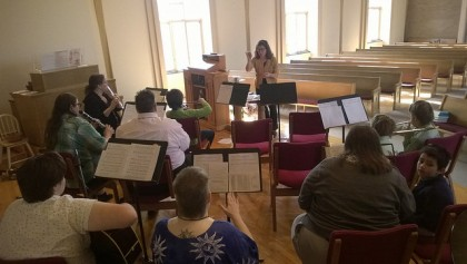 Sara Jo Brandt Doelle and volunteer musicians rehearsing for the Easter Band