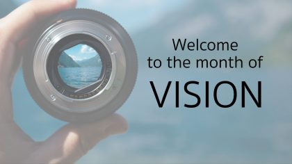 picture of a magnifying lens with the words Welcome to the month of Vision